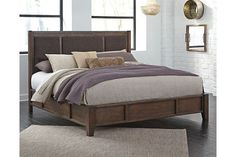 Medium Brown Zenfield King Panel Bed $722 sale. Nice and simple, but not cheap. I like not having a foot board. Hardwood and composite.