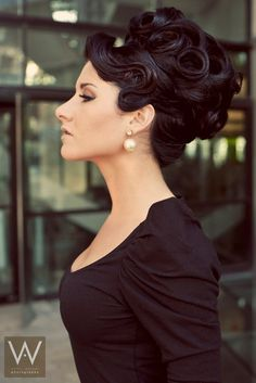 Elegant and super structured, elaborate up-do finished with pin curl details