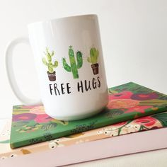 Coffee mug features the quote Free Hugs with 3 succulents.  ▶This is a standard 15oz coffee mug.  ▶The mugs are dishwasher and microwave safe. ▶The design is printed on the front of the mug. The Sams Simple Decor logo is printed on the back of the mug.  ▶Dimensions of the mug: 4.5 H x 3.75 W  ▶Mugs are packaged in a sturdy box with crinkle paper for protection. A picture of the packaging is shown in the third image.