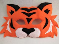 Your little hunter will look adorable in this orange felt tiger mask with black stripes. This jungle cat mask is fully sewn with an elastic back. Perfect for a zoo or jungle themed party or give as an fun and imaginative stocking stuffer. Also avail Hobbies For Adults, Fun Hobbies, Jungle Cat, Jungle Animals, Hobbs New Mexico, Lion King Musical, Tiger Costume, Tiger Mask, Mask Images