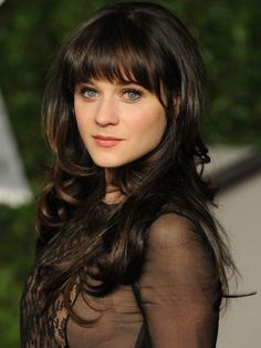 Zooey shows off her flirty side with long hair, loose layers and blunt-cut bangs http://www.ivillage.com/layered-haircuts-and-layered-hairstyles/5-b-346635#346636