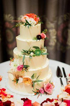 Spring wedding cake adorned with flowers   Photo by M2 Photography via  http://junebugweddings.com/wedding-blog/classy-elegant-hotel-monaco-wedding/