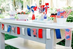 Fourth of July party plans coming up? Let this great outdoor table setting inspire you to go all out! Outdoor Table Decor, Outdoor Table Settings, Paper Flower Centerpieces, Paper Flowers, 4th Of July Party, Fourth Of July, Custom Home Builders, Custom Homes, 4th Of July Decorations