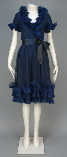 YVES SAINT LAURENT CHIFFON COCKTAIL DRESS, 1965 Midnight blue silk with ruffled cap sleeve and wrap front, triple hem ruffles, satin sash, silk lining and underskirt
