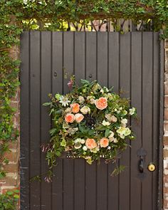 Grace Bonney. A gorgeous floral wreath by Julie of Garden on the Square greets guests as they enter the courtyard behind Harper Fowlkes House, for the reception.