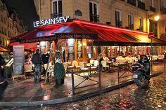 Rain-Soaked Corner Cafe Gleams in Cobblestones of the St. Germain Neighborhood, Paris, France