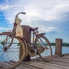 Local fisherman leaves his bike to attend his catch on U Bein Bridge,  Myanmar #lp #wanderlust #travel #travelpics #myanmar #mandalay #bike #beautiful #sunset