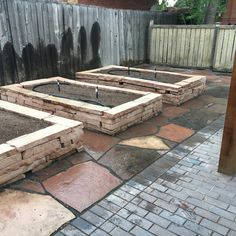 Raised garden beds. Flagstone floor and limestone beds