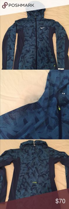 Nike women's trail running jacket Lightweight, packable. Hood rolls up and tucks away. Waist cinch at the mid back. Double zipper. Barely worn- just was too long for me! Jacket of choice for the Nike elite trail running team! Nike Jackets & Coats