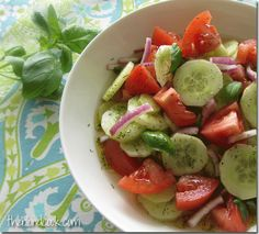 All there is to this recipe is slicing some cucumbers, tomatoes, red onions and chopping some basil……..    Then making a vinaigrette dressing with olive oil, apple cider vinegar, red wine vinegar, dill weed, sugar, salt and pepper.  Drizzle it over the salad.