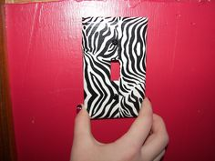 We did this in 10 minutes with duct tape and nail polish (for the screws) for a new zebra room!