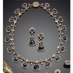 Collana ed orecchini in oro, zaffiri, zaffiri gialli, rubini e diamanti | lot | Sotheby's