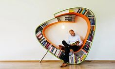 Dutch design firm Atelier 010 has created a furniture piece that combines the function of a chair and a bookcase in an unconventional, organic style. The lowest curve can be used as a seat, while the upper side has a suspended lamp to provide the reader with direct, overhead light source. [Link]