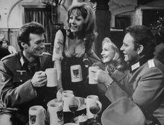 Clint Eastwood, Ingrid Pitt, Mary Ure, & Richard Burton, enjoy mugs of German beer while filming Where Eagles Dare.