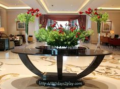 large lobby arrangements | Love this centrepiece flower arrangement. Brightens the whole place ...