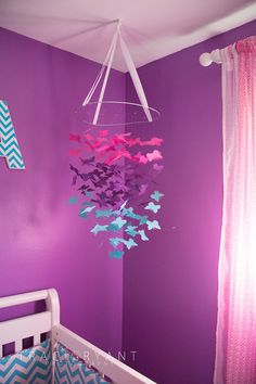 A sweet butterfly mobile in this purple nursery! #nursery #projectnursery