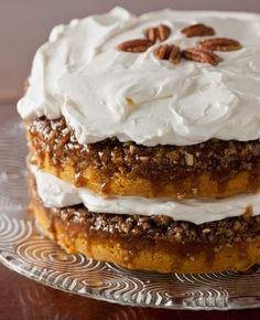 This easy pumpkin cake will be a hit at your Thanksgiving dessert table. It's a simple pumpkin cake with yellow cake mix and canned pumpkin made even better with pecan praline topping. This beautiful and delicious Betty Crocker pumpkin praline cake is perfect for the holidays and it's made even better than the original with homemade whipped cream cheese frosting. | http://pinchmysalt.com