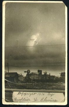I have a very old copy of this picture that was found in my grandfathers family bible when he died. Written on  the back of the print was 1916 Arthur Hutchens - 4 Wells Kansas. Ive gone to the Kansas Historical Society  website and can find no 4/Four Wells Kansas or Tornado of 1916.