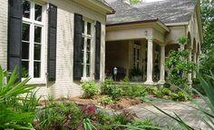 Patio and veranda behind Architectural Designs House Plan 5518BR