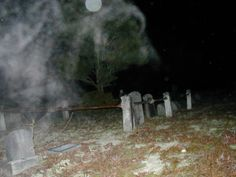 Swirls and a giant orb about a grave site at Pleasant Mills Cemetery in the Pine Barrens. Three out of the four investigators who ventured into the cemetery could hear a conversation between two men. Investigator Bove' snapped this picture at the source of the conversation between the unseen men.