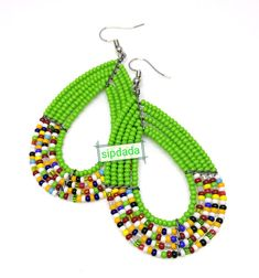 Beautiful green Maasai earrings. These beautiful earrings are 2 inches long and light on the ears. We make all our earrings using high quality beads that do not fade nor chip. To have a similar design made for you but with different colors, feel free to make a custom request order or send