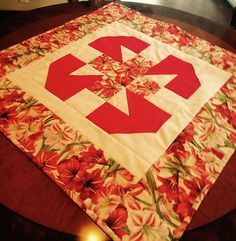 Here is a beautiful Teatime Quilted Tablecloth made by Janome Educator Nancy Burg.