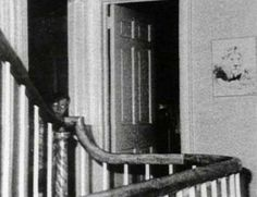 This photo, taken by Ed and Lorraine Warren, claims to show the ghost of 9 year old John DeFeo. DeFeo, along with his other brother, two sisters and parents, were killed by his older brother Ronald at their house in Amityville. Ed and Lorraine Warren were paranormal experts who entered the house and captured this image using a camera that consistently took infrared photos during the night.