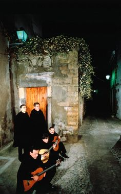 A group of students from the university perform a fado serenade in the traditional student outfit that is still a common sight