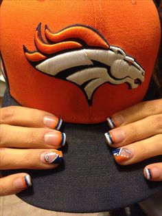 I think I'll get my nails done like this for the super bowl. Was actually my husband's idea, lol. He's been a Broncos fan since he was a kid.