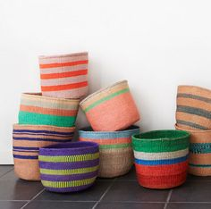 Artisan: Kasigau WeaversThis hand-woven basket is crafted from natural sisal fibers in a range of vibrant colours found in the national dress of Kenya.Kenya is Basket Weaving, Hand Weaving, Woven Baskets, Picnic Baskets, Gift Baskets, Kenya, Black Basket, Toy Basket, Sisal