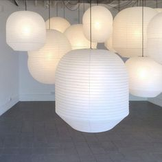 Japanese-made paper Hotaru lamps by Barber & Osgerby via Present and Correct   Remodelista
