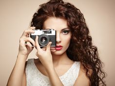 Portrait of beautiful woman with the camera. Girl photographer by Oleg Gekman - Photo 128150389 - 500px