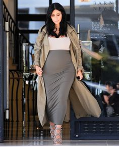 The busy mom stopped by Barney's in a layered ensemble that included a high waist skirt, a beige top, and a floor sweeping jacket. She finished the look with a sold out pair of Jimmy Choo sandals. AUGUST 10, 2015