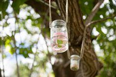 Flower-filled mason jars decorated the Hawaiian ceremony space! {Rachel Robertson Photography}