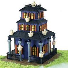 #KatieSheaDesign ♡❤ ❥ How to make a Good Housecreeping Cake. This old haunt is custom-built with Color Flow windows and doors, gingerbread roof panels and royal icing fences and turrets.