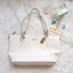 NEW LISTING Coach Ava Tote- Chalk This bag is beautiful! It's armor leather, so SUPER soft and in a beautiful white color. Gold accents and a pure white inside make this a perfect spring/summer bag. There's a minor mark by the strap (last photo). 17x5x10 Coach Bags Totes