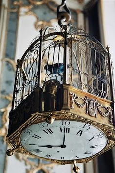 A bird in a cage with a clock bottom ... interesting! #antique