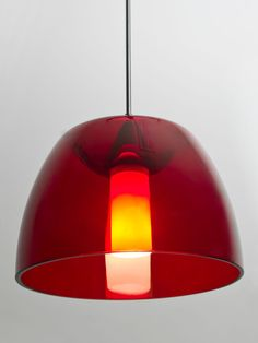 The Spur Red/Frost is a distinctive double-glass pendant, with an inner frosted cylinder centered within a transparent softly radiused outer glass. The transparent red blown outer glass complements the soft white Opal cased glass, which can suit any modern decor. The inner tranquil glow is pleasing in appearance, as the sophisticated outer glass sparkles with the accents from that glow.  Visit our website to learn more about Spur…