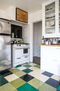 Floor of vinyl tiles... white and black and color... Erin's Eclectic Mystic Home & Traveling Tarot Caravan