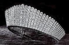 British Royal Jewels: The Russian Kokoshnik Tiara - 1888 by Garrard Jewelers: a gift to Princess Alexandra, Princess of Wales from Lady Salisbury on behalf of 365 peeresses of the United Kingdom. Alexandra had requested that the tiara be in the fashionable design of a Russian girl's headdress, a kokoshnik. It is made up of 61 platinum bars and encrusted with 488 diamonds, the largest of which are 3.25 carats each.