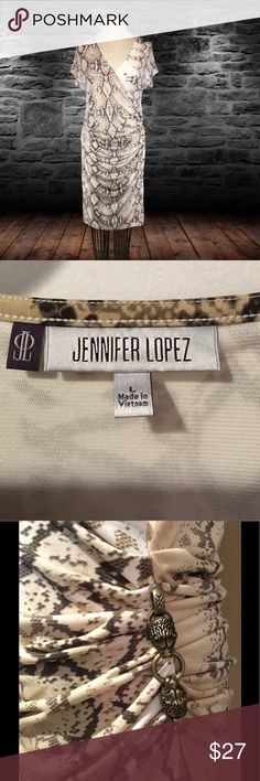 Jennifer Lopez rusched side dress with detail This is a fabulous rusched side dress! It has stretch in the material, snake skin print, sassy! Lion head detail on left hip. This dress has been worn once only. Hemline falls just about the knee. Jennifer Lopez Dresses