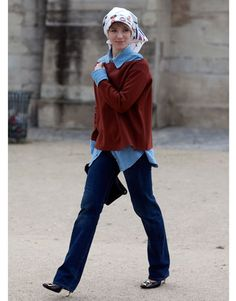 Street Style: Paris Fashion Week  Vika Gazinskaya's take on denim: She always dresses up the look with chic layering via a sweater or coat, her signature favorite Roger Vivier pumps and a beautiful headdress.