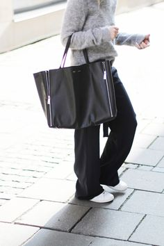 Mija is wearing a a grey mohair jumper from Acne Studios, black wide leg trousers from Zara, bag from Celine and Stan Smith sneakers from Ad...