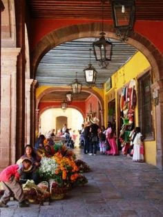 Flower sellers in the jardin, San Miguel de Allende, Mexico.