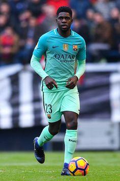 Samuel Umtiti of FC Barcelona runs with the ball during the La Liga match between CA Osasuna and FC Barcelona at Sadar stadium on December 10, 2016 in Pamplona, Spain.