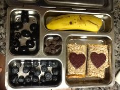 Olives, blueberries, banana, fruit leather hearts and AB on an Ezekiel Tortilla