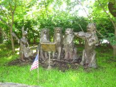 Animal symphony memorial at Hartsdale Pet Cemetery includes bronze figures of cats and a rabbit.