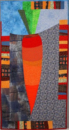"""Carrot, 17 x 37"""", by Linda Frost at 13th Street Studio. Design:  Pieced Vegetables by Ruth B. McDowell"""