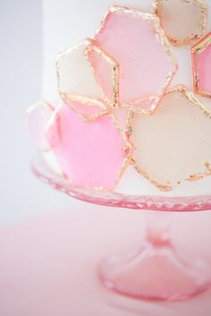 Fun geometric pink and gold design, for this modern wedding cake.