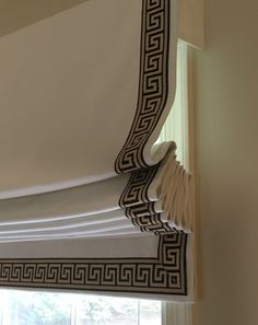 Ivory twill roman shades with greek key trim